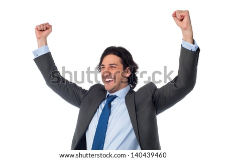 Successful businessman clenching his fists in excitement