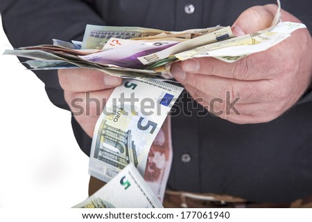 Successful businessman counting his money - stock photo