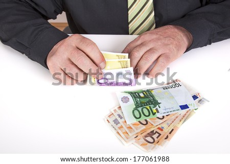 Successful businessman counting his money