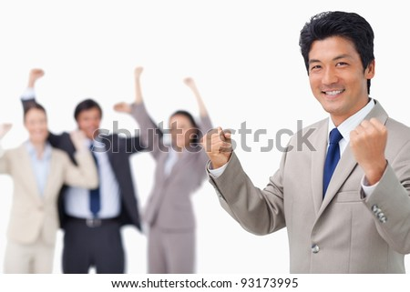 Successful businessman getting celebrated by colleagues against a white background - stock photo