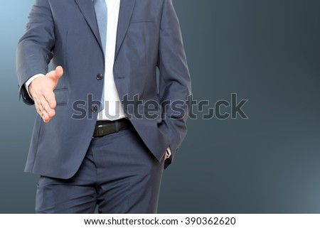 successful businessman giving a hand.Ready to seal a deal