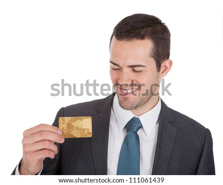 Successful businessman holding credit card. Isolated on white