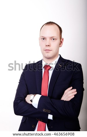 Successful businessman in formal suit chacking time on wrist watch isolated over white