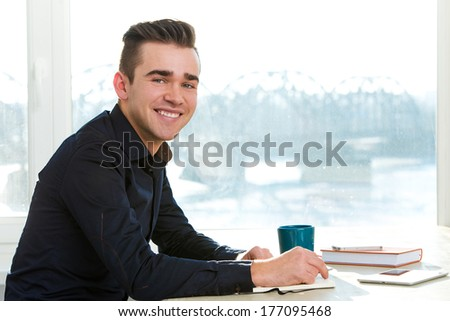 Successful businessman in office - stock photo