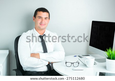successful businessman in the office - stock photo