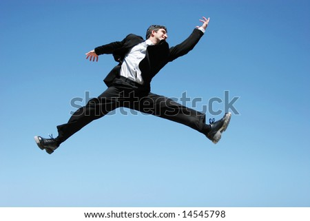 Successful businessman jumping to celebrate