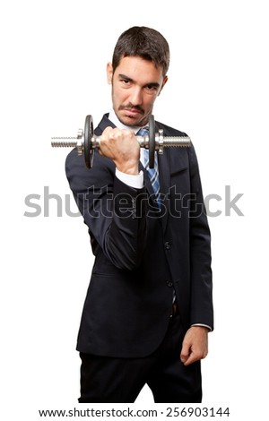 Successful businessman lifting a dumbbell