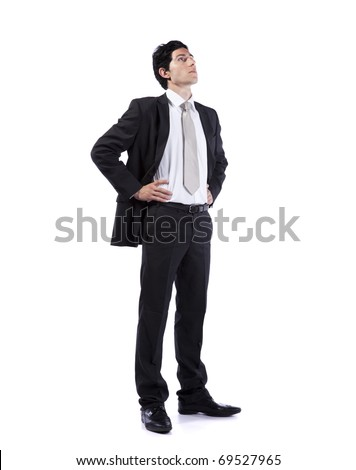 Successful businessman looking up to the copy space (isolated on white) - stock photo