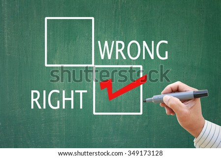 successful businessman making the RIGHT choice on green board for decision skill for business administrator - stock photo