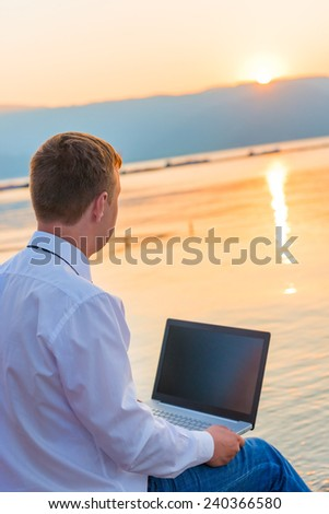successful businessman on the beach with a laptop