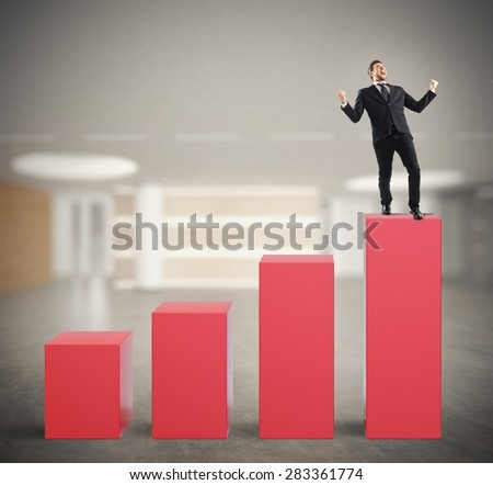 Successful businessman on the top of a statistic bar - stock photo