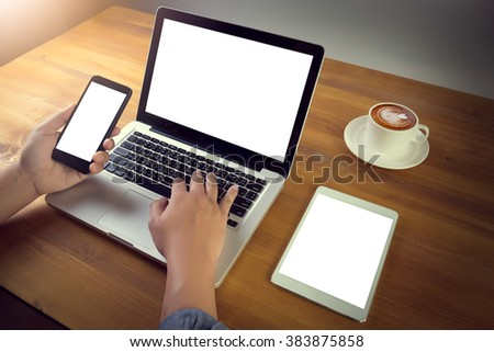 Successful businessman or entrepreneur wooden table with style accessories, open laptop computer and digital tablet with white blank copy space screen for text information or content,e-business,filter - stock photo