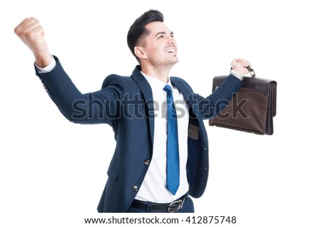 Successful businessman or salesman concept making joyful cheerful gesture with arms up - stock photo