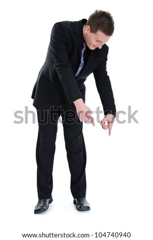 Successful businessman pointing down isolated - stock photo