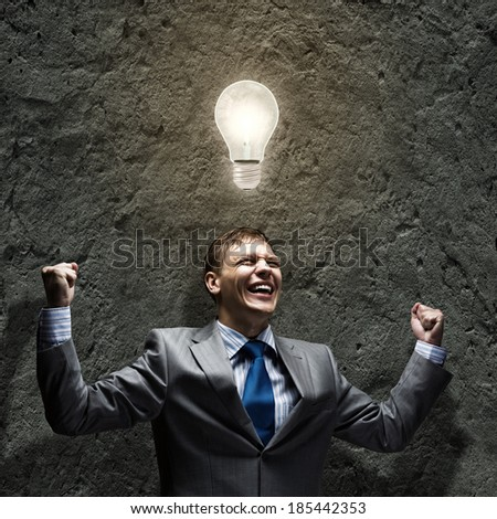 Successful businessman screaming joyfully in to sky