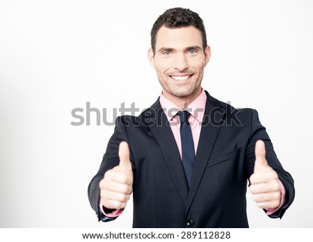 Successful businessman showing double thumbs up  - stock photo
