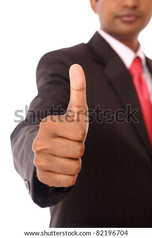 successful businessman showing the success sign.