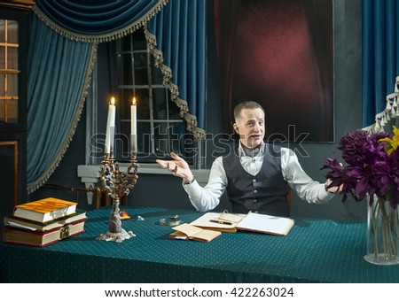 Successful businessman sitting at the table in his study