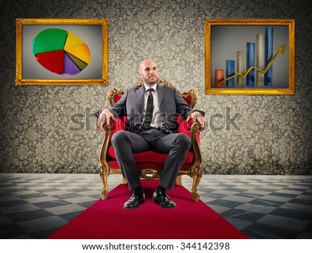 Successful businessman sitting on a royal armchair - stock photo