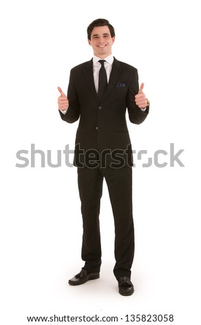 Successful businessman standing facing the viewer with a cheerful smile giving a double thumbs up of approval isolated on white - stock photo