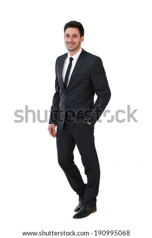 Successful businessman standing on white background