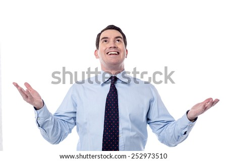 Successful businessman standing with open arms - stock photo