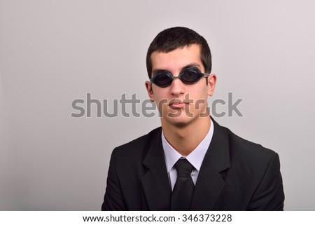 Successful businessman wearing goggles for water, thinking at vacation. Concept of working hard without holiday - stock photo