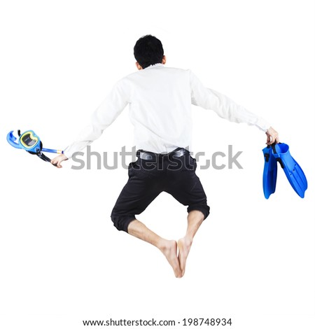 Successful businessman wearing snorkeling gear standing on white background - stock photo