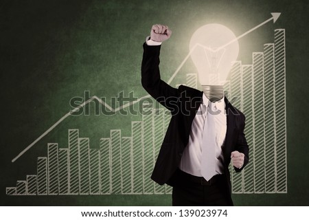Successful businessman with bar chart - stock photo