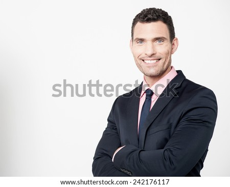 Successful businessman with folded arms