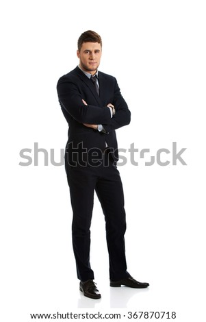 Successful businessman with folded arms. - stock photo