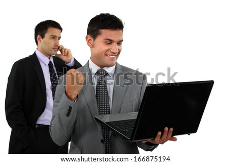 Successful businessman with laptop - stock photo