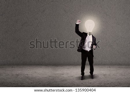 Successful businessman with lightbulb head - stock photo