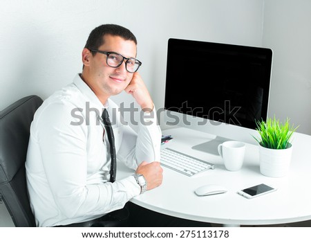 successful businessman working a the office - stock photo