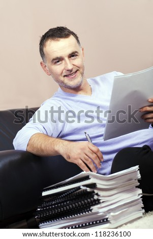 Successful businessman working at home. - stock photo