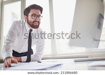 Successful businessman working with computer in office