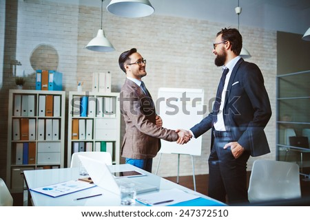 Successful businessmen handshaking after negotiation - stock photo