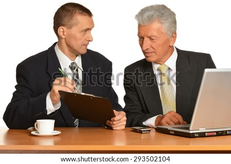 Successful Businesspeople at work on white background - stock photo
