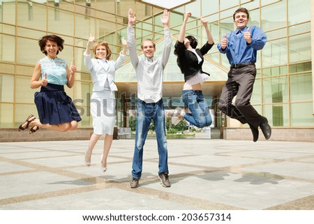 Successful businesspeople  jumping near building office - stock photo