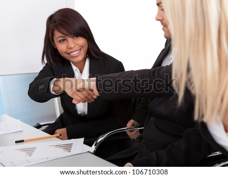 Successful businesspeople shaking hands in the meeting - stock photo
