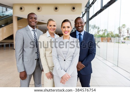 successful businesspeople team looking at the camera - stock photo
