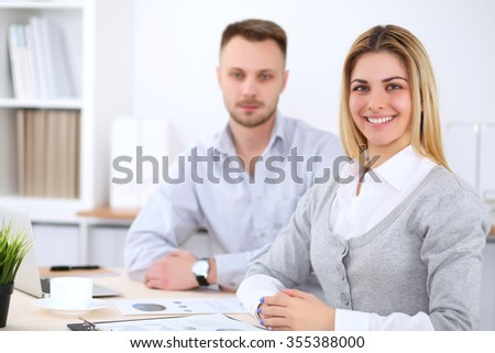Successful businesspeople  working at meeting in office. Business woman looking at camera. Start up business concept. - stock photo