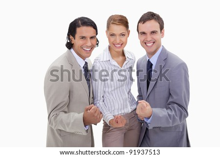 Successful businessteam standing together against a white background