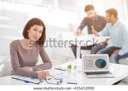Successful businesswoman and business team at office meeting - stock photo