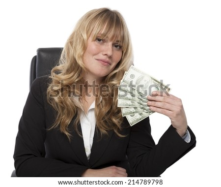Successful businesswoman fanning herself with a fistful of money composed of American dollar banknotes looking at the camera with a smile of satisfaction, on white
