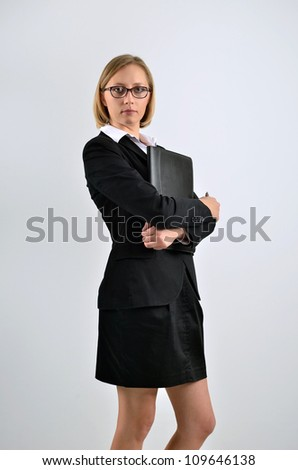 Successful businesswoman holding a folder and looking to us - stock photo