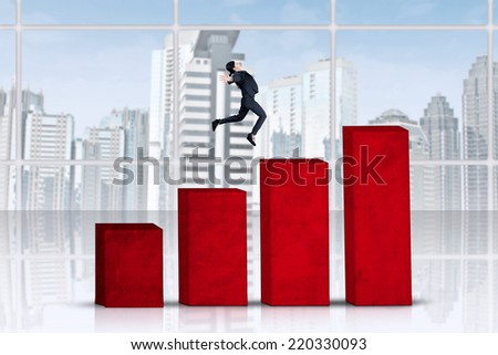 Successful businesswoman jumping over business graph
