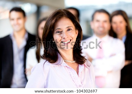 Successful businesswoman leading a group and smiling