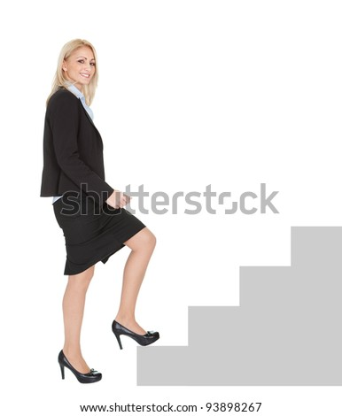 Successful businesswoman walking up a staircase. Isolated on white - stock photo