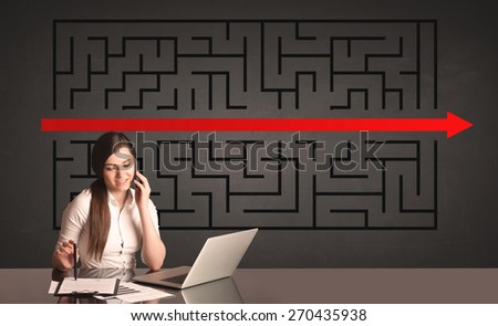 Successful businesswoman with a solved puzzle in background  - stock photo